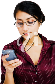 Confident woman text messaging on a mobile phone isolated over white