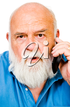 Angry man talking on a mobile phone isolated over white