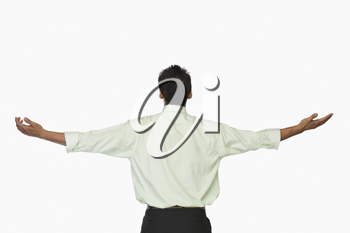 Rear view of a businessman with his arms outstretched