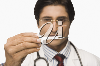 Close-up of doctor reading a thermometer
