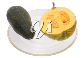 Cut and courgettes in a transparent plate on a white background.