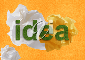 Royalty Free Photo of an Abstract Background With the Word Idea Created in Green Grass With Scrunched up Papers
