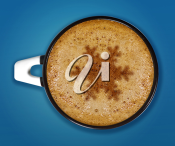 Royalty Free Photo of a Cup of Cappucino With a Symbol of a Snowflake in the Center on a Blue Background