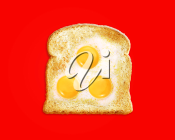 fried egg with toast on a Red background,
