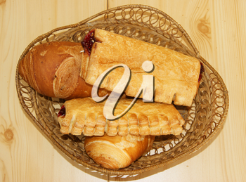 Basket with pie and bread on table