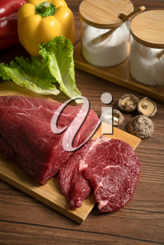 Raw beef with wooden table background, still life photography.