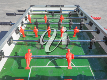 Table football aka table soccer, foosball from the German Tischfussball, baby-foot or kicker table-top game and sport