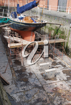 Royalty Free Photo of Antique Boat Reparation at Dry Docks