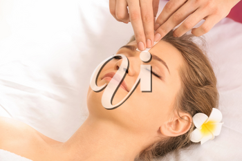 Woman having hair removal procedure on face with wax in salon