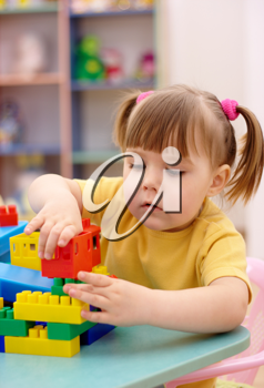 Royalty Free Photo of a Girl Playing With Blocks