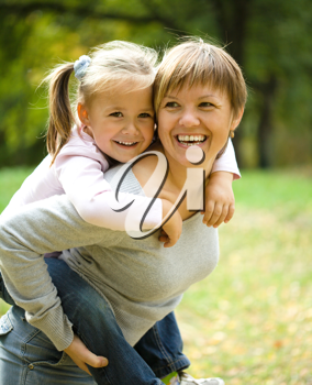 Royalty Free Photo of a Mother and Child Playing Outside