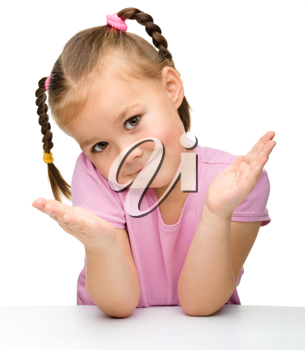 Royalty Free Photo of a Little Girl Shrugging