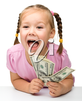 Royalty Free Photo of a Happy Little Girl With Money