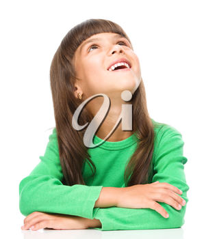 Portrait of a cheerful little girl touching his cheek with index finger, isolated over white