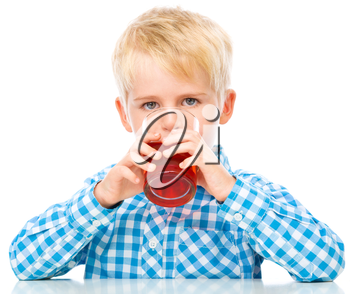 Little boy is drinking cherry juice, isolated over white