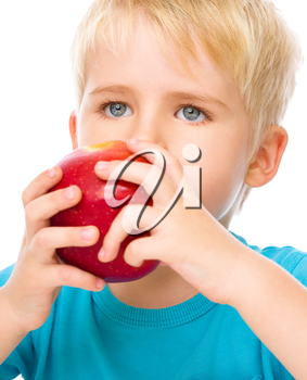 Portrait of a cute little boy with red apple, isolated over white
