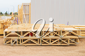 stack of wooden joists and building lumber at construction cite