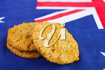 Traditional  Anzac biscuits on  Australian flag as background