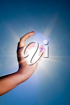 Royalty Free Photo of a Woman's Hand Circling the Sun