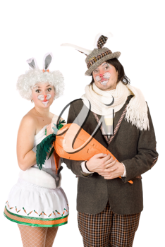 Royalty Free Photo of a Man and Woman in Bunny Costumes With a Big Carrot