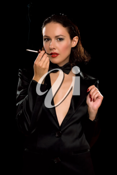 Royalty Free Photo of a Woman Smoking a Cigarette in a Holder