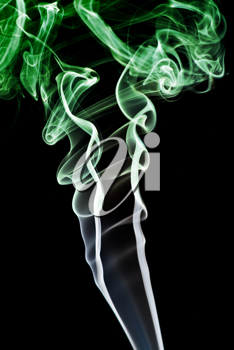 Royalty Free Photo of Green Smoke on a Black Background