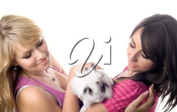 Royalty Free Photo of Two Women Playing With a Rabbit