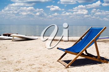 Royalty Free Photo of a Chair on the Beach