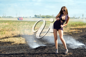 Royalty Free Photo of a Woman in a Burning Field