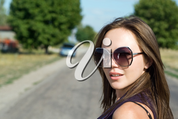 Royalty Free Photo of a Woman on a Road