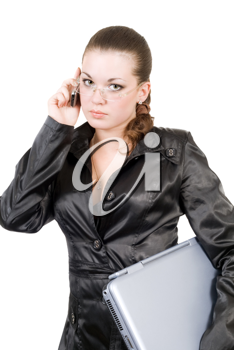 Royalty Free Photo of a Woman in Black Holding a Laptop and Talking on the Phone