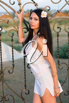 Portrait of pretty young woman in white dress