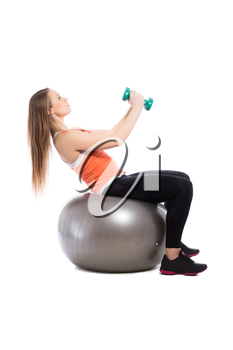 Slim and sporty woman training on a fit. Isolated