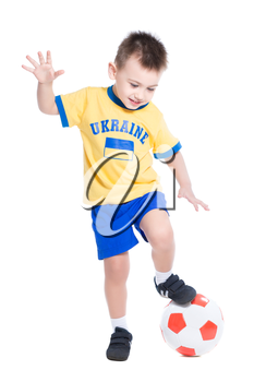 Nice little Ukrainian boy playing in football. Isolated on white
