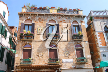 VENICE, ITALY - MAY 06, 2014: Facades of the houses on the street in Venice, Italy