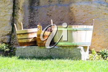 Wooden buckets and tubs in the courtyard of fortresses Guaita on Mount Titan. The Republic of San Marino