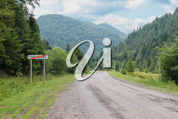 Country road between small settlements in the Carpathians, Ukraine