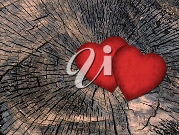 two red paper hearts on a grungy wooden background
