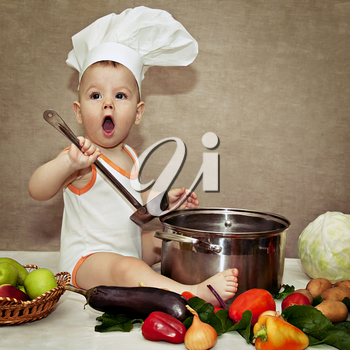 little baby in a chef's hat and ladle in hand