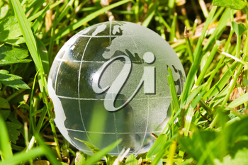 Environment or ecology concept, glass globe in the grass