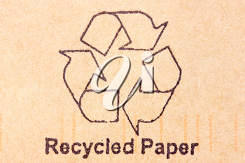 Brown recycled paper with black recycle symbol