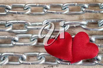 Metal chain with two hearts as a symbol of strong love