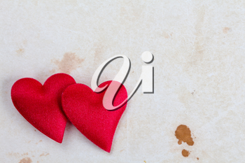 Two decorative hearts on stained paper with copy-space