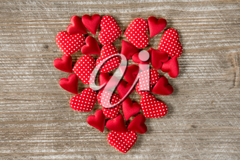 Heart shape formed with small hearts on wooden background. Love concept. Valentine's Day concept.