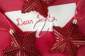 Christmas decoration and envelope with child's letter to Santa