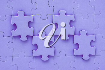 Close up top view shot of purple jigsaw puzzle background