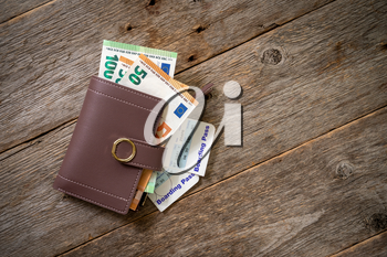 Traveling concept with wallet, money, and  airplane boarding passes