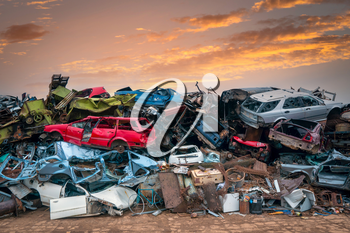 Damaged cars on the junkyard waiting for recycling or destruction
