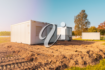 Construction trailers for workers at the new construction site. Mobile containers and cabins base for the site manager and employees.