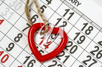 Memorable cute heart pendant on the February 14th monthly calendar. Valentine's day background